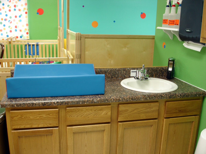 Diapering area has sensory activated faucet & soap to reduce cross contamination